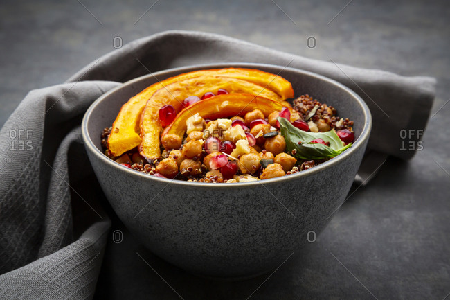 Red quinoa with baked pumpkin- chickpeas- pomegranate- basil- walnuts and pumpkin seeds