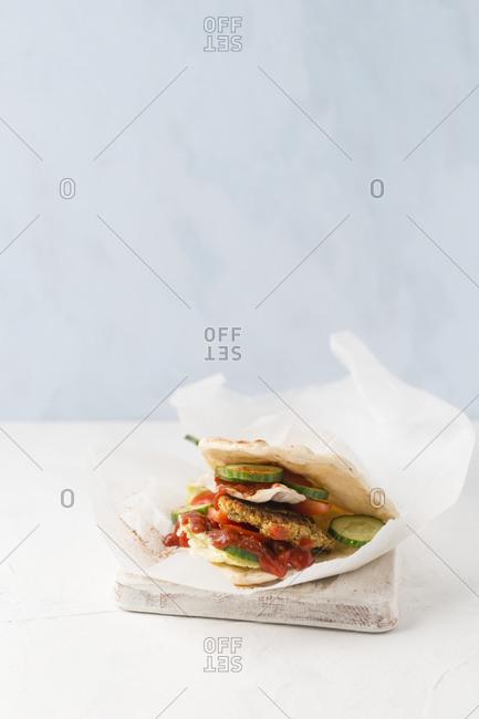 Studio shot of falafel veggie burger with pita bread