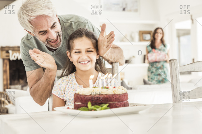 Father and mother celebrating daughter\'s birthday