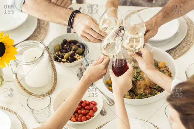 Close-up of family having lunch together toasting