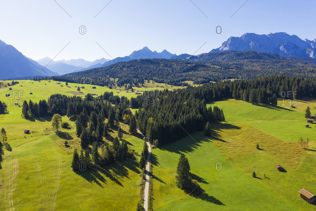 Germany- Bavaria- Mittenwald- Drone view of Buckelwiesen meadow in spring with Wetterstein Mountains in background