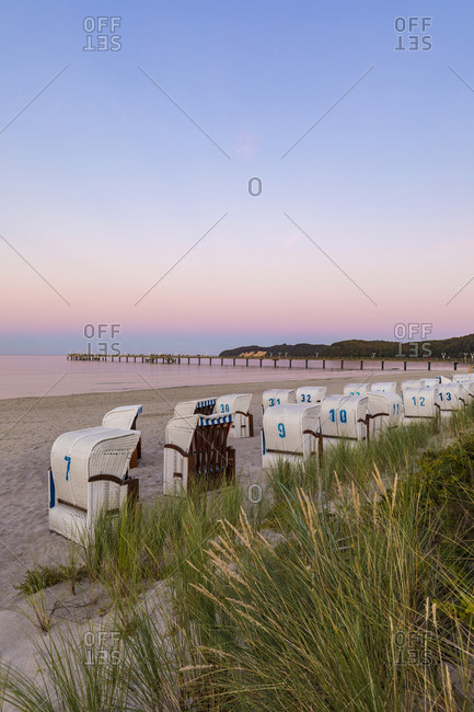 Germany- Mecklenburg-West Pomerania- Rugen Island- Binz- Ostseebad- Wicker beach chairs on beach at sunset