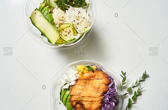 Overhead view of healthy take-away salads for lunch