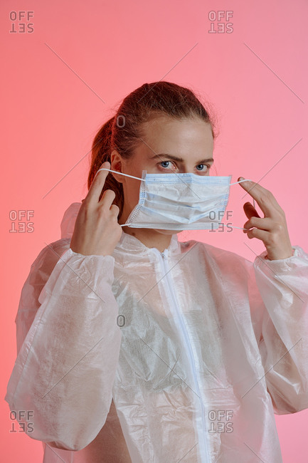 Woman dressing in protective medical gear