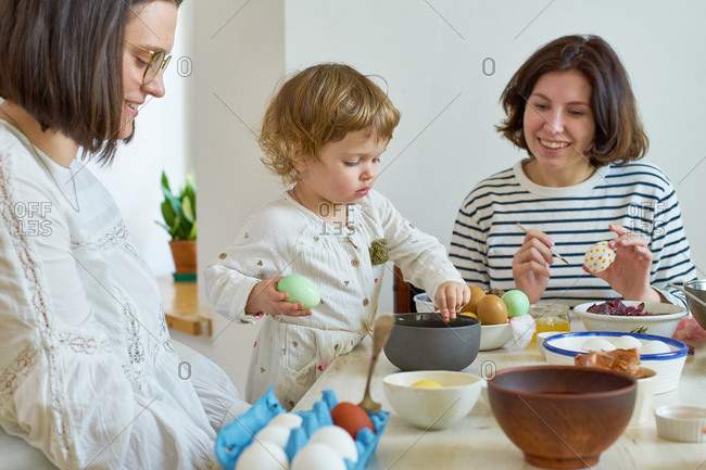A family painting eggs for Easter celebration