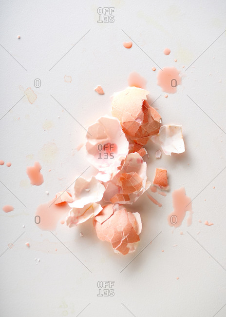 Top view still life with pink egg shell