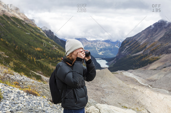 Redhead woman taking photos at Banff National Park Canada