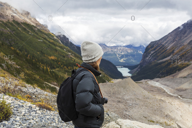 Woman admiring a rocky mountain landscape view