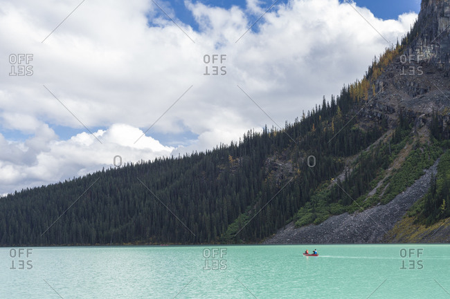 People canoeing in Lake Louise, Banff National Park, Canada