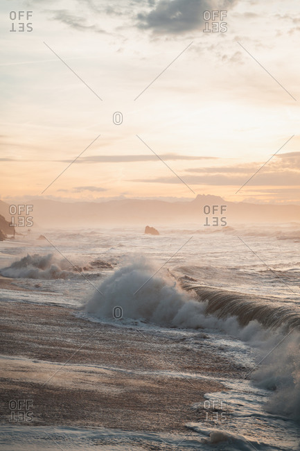 Big waves crashing on the seashore of Biarritz