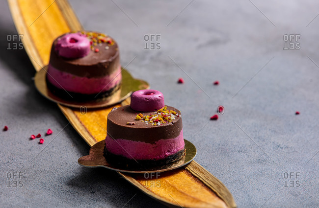 little cakes of cacao and cherries on palm leaves