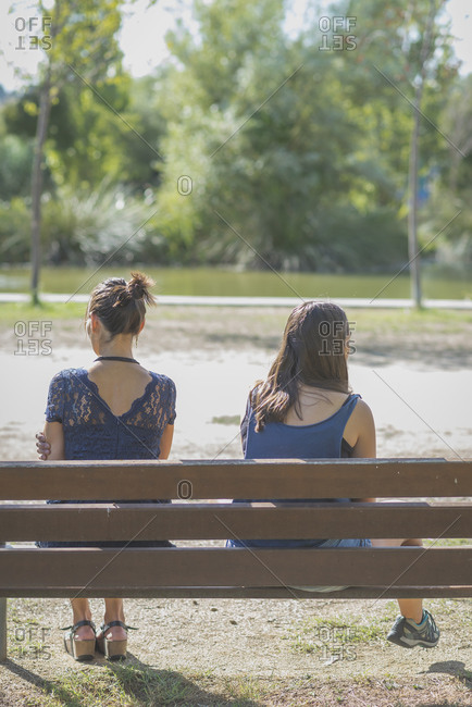 Mother and daughter having an intense discussion outdoors at a park