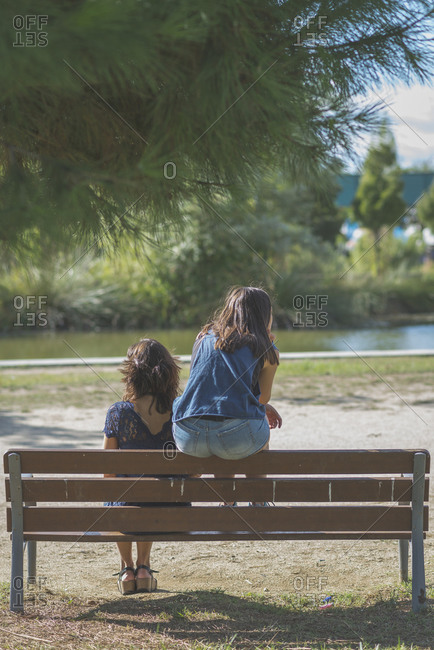 Mother and daughter having a disagreement outdoors at a park
