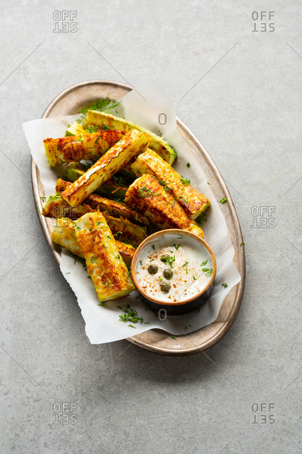 Zucchini wedges roasted with cheese
