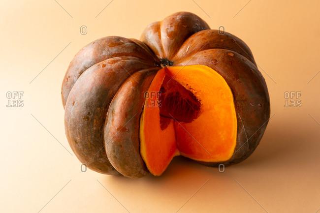 Orange pumpkin on orange background