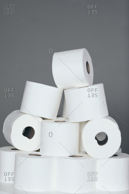 Multiple rolls of toilet paper stacked on top of each other.
