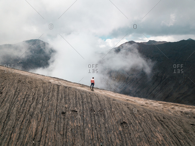 Aerial view of a man watching Mount Bromo, East Java, Indonesia