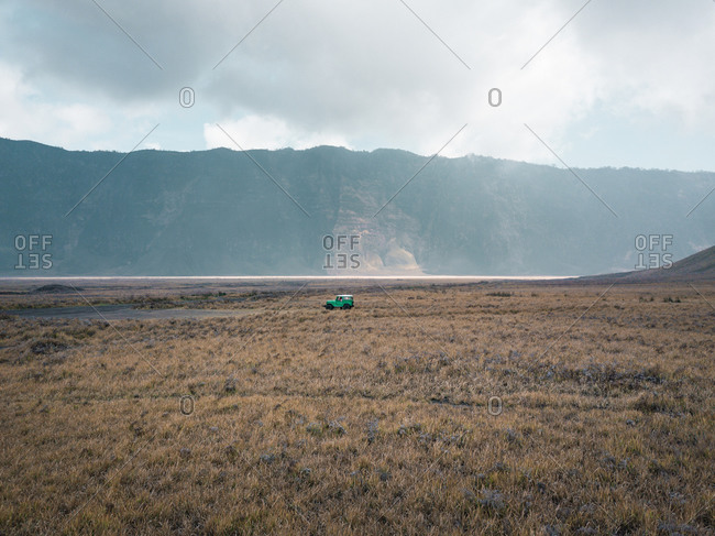 Aerial view of an all-terrain car under Mount Bromo, East Java, Indonesia
