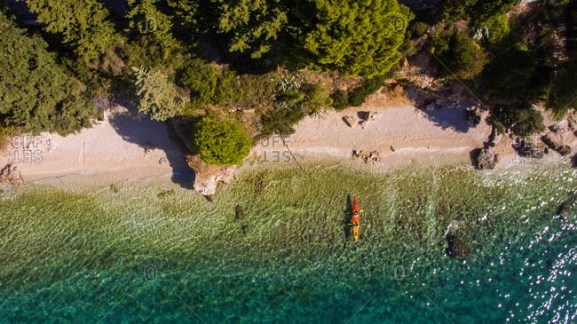 Aerial view of kayakers padlling near beach in Brist in Dalmatia, Croatia.