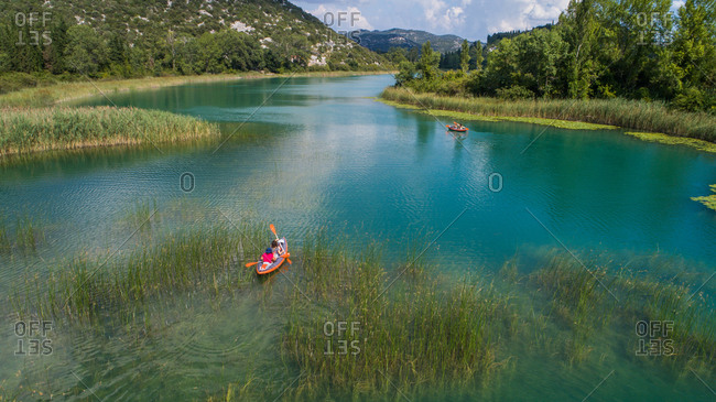 Aerial view of group of kayakers paddling on Basina lakes near the city of Polce in Dalmatia, Croatia.