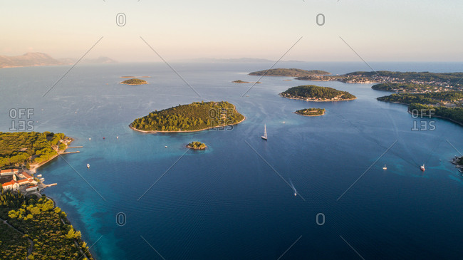 Aerial view of Kordula nad island archipelago near it with Lumbarda town in distance. Situated in Dalmatia, Croatia.