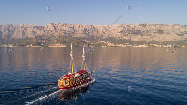 September 18, 2018: Aerial view of tourist boat on Adriatic sea near Makarska city and Hvar and Bra? islands in Dalmatia, Croatia.