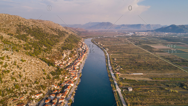 Aerial view of small town of Komin and Neretva river. Situated near Opuzen in Dalmatia, Croatia.