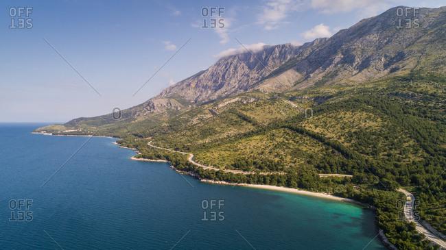 Aerial view of seacluded beach and Biokovo mountain near Drvenik in Dalmatia, Croatia.