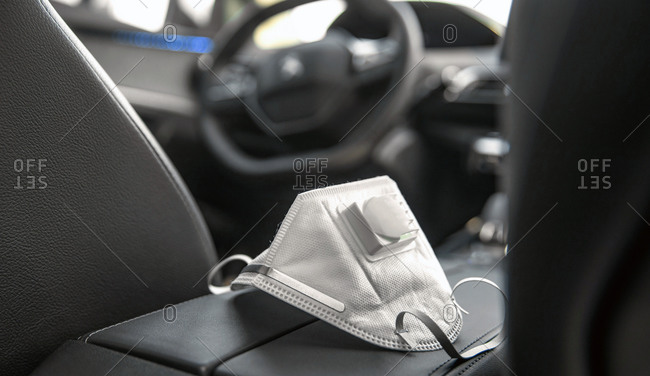 Medical mask sitting on the center consol of a car