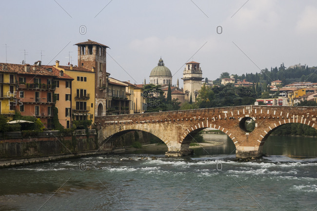 The ancient Ponte Pietra bride crossing the waters of the River Adige in Verona, Italy