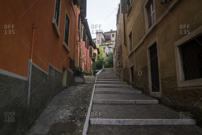 Stairs lead up through a residential area on a hillside in Verona, Italy