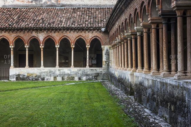 October 9, 2013: Loggia and garden in the Chiostro Basilica di San Zeno in Verona, Italy