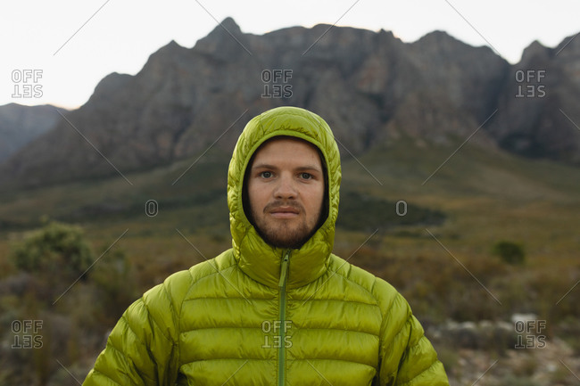 Portrait of a Caucasian man having a good time on a trip to the mountains, wearing warm clothes, looking at the camera