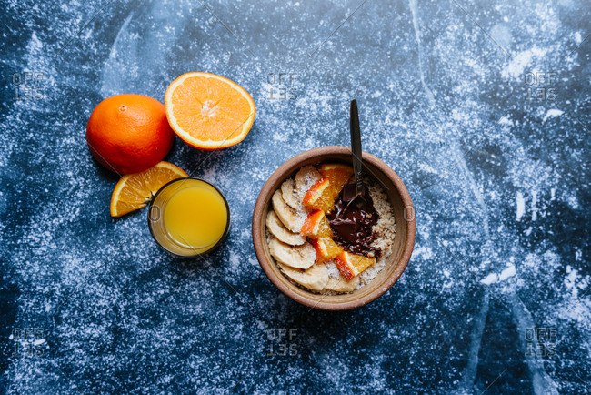 Oatmeal with chia seed, bananas and oranges served with orange juice
