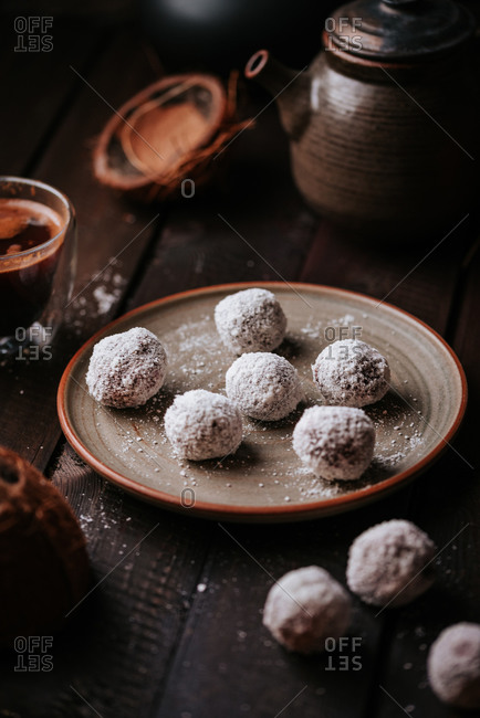 Raw coconut and dates balls with homemade coffee