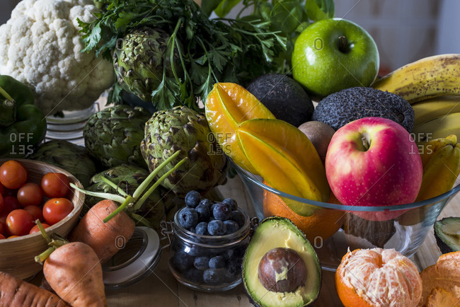 Close-up collection of farm fresh fruits and vegetables in natural light