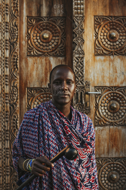 Masai men standing in front of a traditional door in old town
