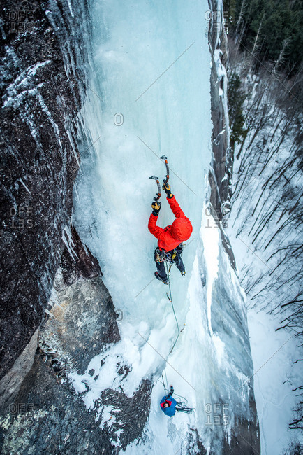 Man ice climbing on Cathedral Ledge in North Conway, New Hampshire