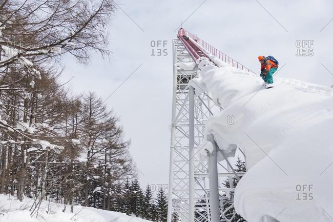 Man snowboarding on rollercoaster in Japan