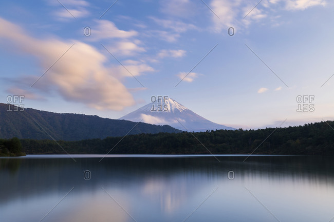 View of Mount Fuji at sunset on a peaceful afternoon from lake Saiko, Yamanashi Prefecture, Japan