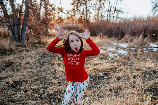 Young girl making a silly face wearing fun Christmas clothes