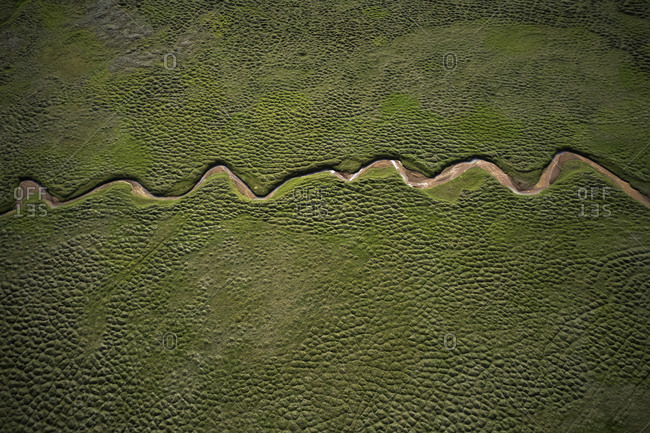 Breathtaking aerial landscape of curving river road in green place