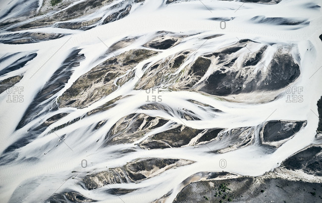 Frozen river streams covering cold mountainous area