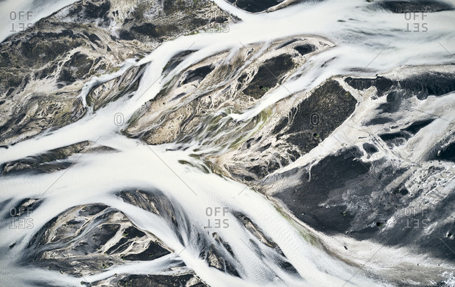 Snow clad water streams covering mountainous land