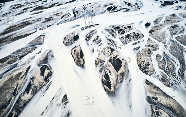 Snow masses covering mountainous land and moving with wind