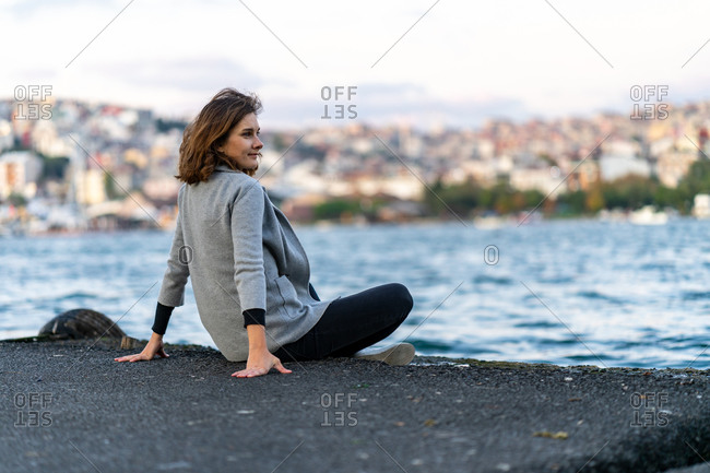 Young woman looking at Istanbul hills over Golden Horn