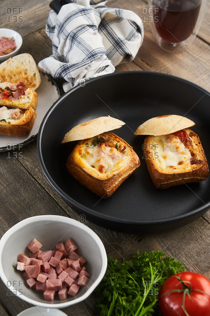 Ham and cheese stuffed baguettes in a skillet