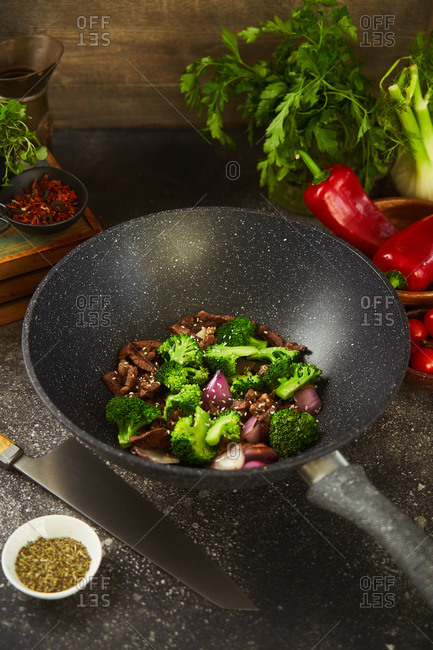 Steak and vegetable dish being prepared in a wok