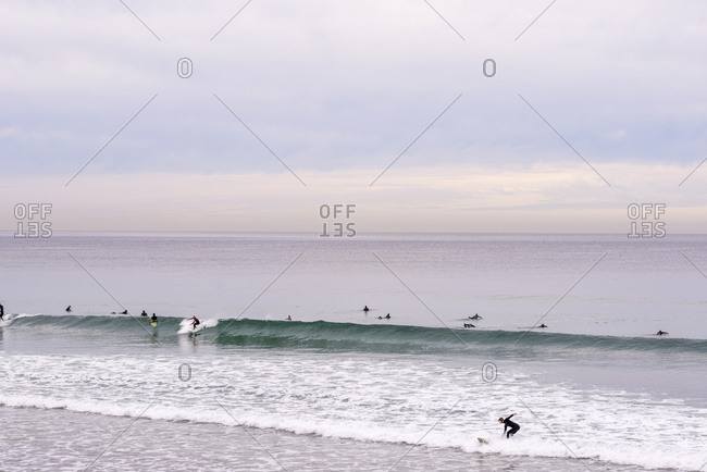Surfers at La Jolla Shores Beach on a winter morning.