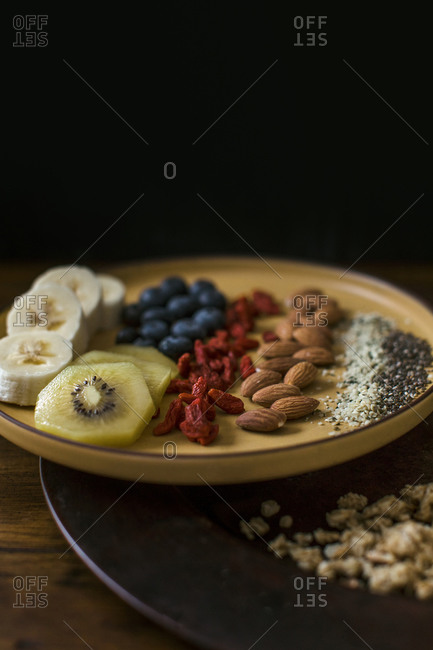 Healthy breakfast plate of fruit and seeds